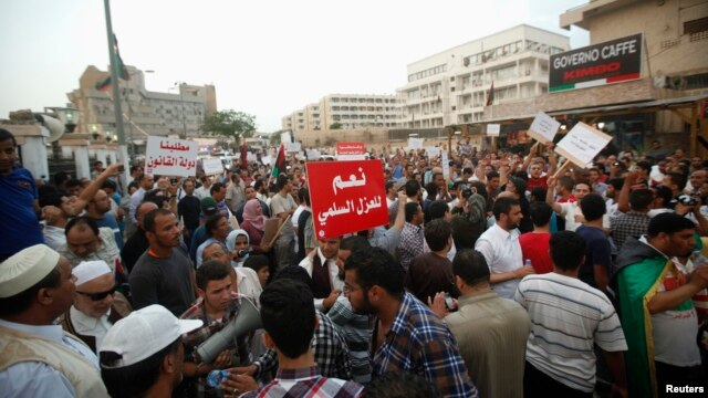 Pro-government protesters rally against gunmen who have taken control of two ministries in the capital, in front of the Libyan Prime Minister's residence, in Tripoli, Libya, May 3, 2013.