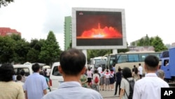 FILE - People watch a news broadcast about a missile launch in Pyongyang, North Korea, July 29, 2017. North Korean leader Kim Jong Un says the second flight test of an intercontinental ballistic missile demonstrated his country can hit the U.S. mainland.