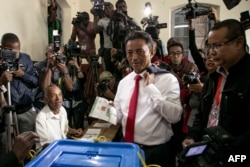 FILE - Malagasy Presidential Candidate Marc Ravalomanana casts his ballot at the polling station in Faravohitra district during the 2nd round of the presidential election, in Antananarivo, Dec. 19, 2018.