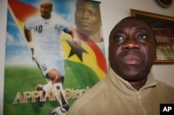 'Uncle' Ben Owusu, inside his Johannesburg restaurant, says Ghana will beat Uruguay in today's World Cup quarterfinal