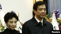 China's former Chongqing Municipality Communist Party Secretary Bo Xilai (R) and his wife Gu Kailai.