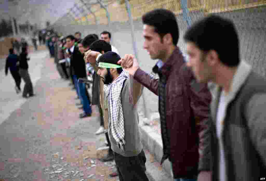 Iranian students form a human chain around the Uranium Conversion facility to show their support for Iran's nuclear program in Isfahan, Iran, November 15, 2011. (Reuters)