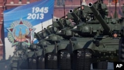 Russian tanks move along Red Square during a Victory Day parade, Moscow, May 9, 2013.