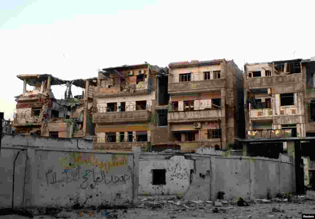 A view shows damaged buildings and debris in the Khaldiyeh district of Homs, May 9, 2013.