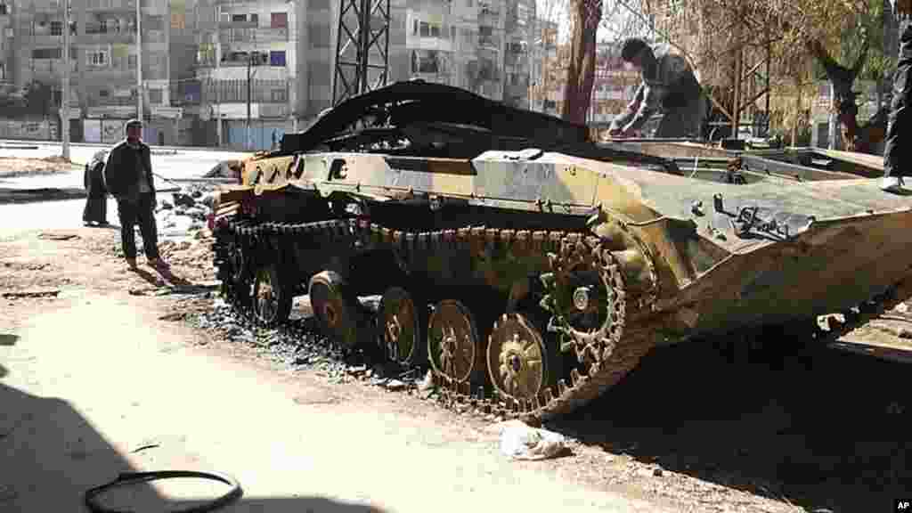 A damaged armored vehicle belonging to the Syrian army is seen in the al-Khalidya district in Homs, February 20, 2012. (Reuters)
