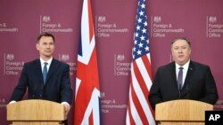 U.S. Secretary of State Mike Pompeo, right, and Britain's Foreign Secretary Jeremy Hunt speak at a joint press conference at the Foreign Office in London, May 8, 2019.