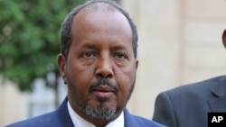 FILE - Somalia President Hassan Sheikh Mohamud addresses the media following his meeting with French President Francois Hollande at the Elysee Palace in Paris.