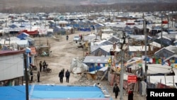 "A general view shows a makeshift camp for people affected by the 2010 earthquake in Yushu, Qinghai province, April 23, 2012. Government officials are threatening to forcibly relocate some 600 people - mostly Tibetans - from what was prime real estate in order to rebuild Gyegu - known in Chinese as Yushu - as what officials billed as an ""ecological tourism centre"". The move has triggered resentment as two of China's most volatile social issues - land grabs and perceived mistreatment of ethnic minorities - combine to raise tensions and threaten social stability in the region. Picture taken April 23, 2012."
