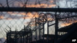 FILE - Dawn arrives at the now closed Camp X-Ray at Guantanamo Bay Naval Base, Cuba, Nov. 21, 2013. Camp X-Ray was the first facility in which the U.S. military held terror suspects.