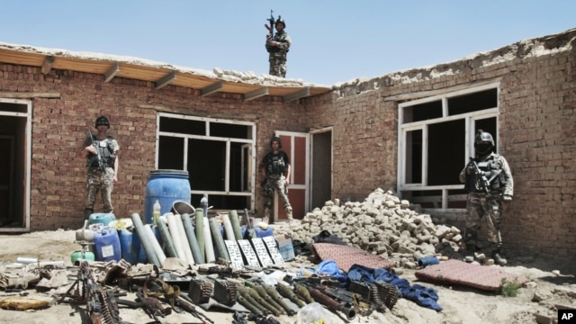 Arms and ammunition belonging to militants are displayed after they were killed during a gun battle with Afghan security forces on the outskirts of Kabul, Afghanistan, August 2, 2012.