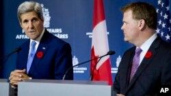 Госсекретарь США Джон Керри с министром иностранных дел Канады Джоном Бэйрдом