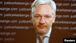 FILE - WikiLeaks founder Julian Assange appears via video link at a news conference in London, Feb. 5, 2016. A Swedish appeals court has upheld a warrant for his arrest.