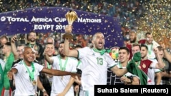 Soccer Football - Africa Cup of Nations 2019 - Final - Senegal v Algeria - Cairo International Algeria's Islam Slimani celebrates with the trophy and team mates after winning the Africa Cup of Nations REUTERS/Suhaib Salem - RC18789B7170