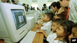 Visitors watch as Cambodian orphans learn computer skills and exploring the Internet world during the opening ceremony at the Future Light Orphanage on the outskirt of Phnom Penh, file photo.