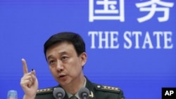 Defense Ministry spokesman Wu Qian speaks during a press conference at the State Council Information Office in Beijing, Wednesday, July 24, 2019.
