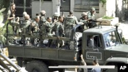 Syrian troops, in this citizen journalism image, August 14, 2011