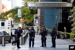 New York City Police Dept. officers arrive outside the Time Warner Center, in New York, Oct. 24, 2018.