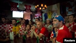 Croatian fans react to being behind late in the opening soccer match of the 2014 World Cup in the Astoria neighborhood of Queens, New York, June 12, 2014.