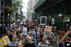 A large group of protesters march in New York City, reacting to recent police-related shootings of two black men in Minnesota and Louisiana, July 7, 2016.