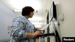 Geisinger Health System maternity ward nurse Nichole Madara enters and checks patient medical records in Geisinger's computerized health records system on the Geisinger Health Campus in Danville, Pennsylvania, Oct. 29, 2009.