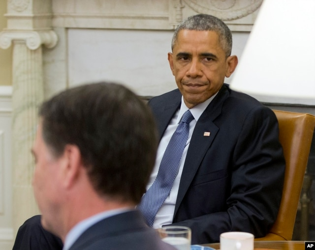 President Barack Obama, right, sits with FBI Director James Comey before speaking to members of the media about the shooting in Chattanooga, Tenn., from the Oval Office of the White House in Washington, July 16, 2015.