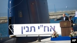 FILE - Israeli Prime Minister Benjamin Netanyahu speaks during a ceremony following the arrival of a German-built INS Tanin, a Dolphin AIP class submarine, at a naval base in Haifa, Israel, Sept. 23, 2014.