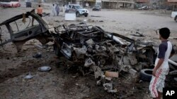 Hiện trường 1 vụ nổ bom xe ở Baghdad, Iraq, thứ Tư 7/8/2013