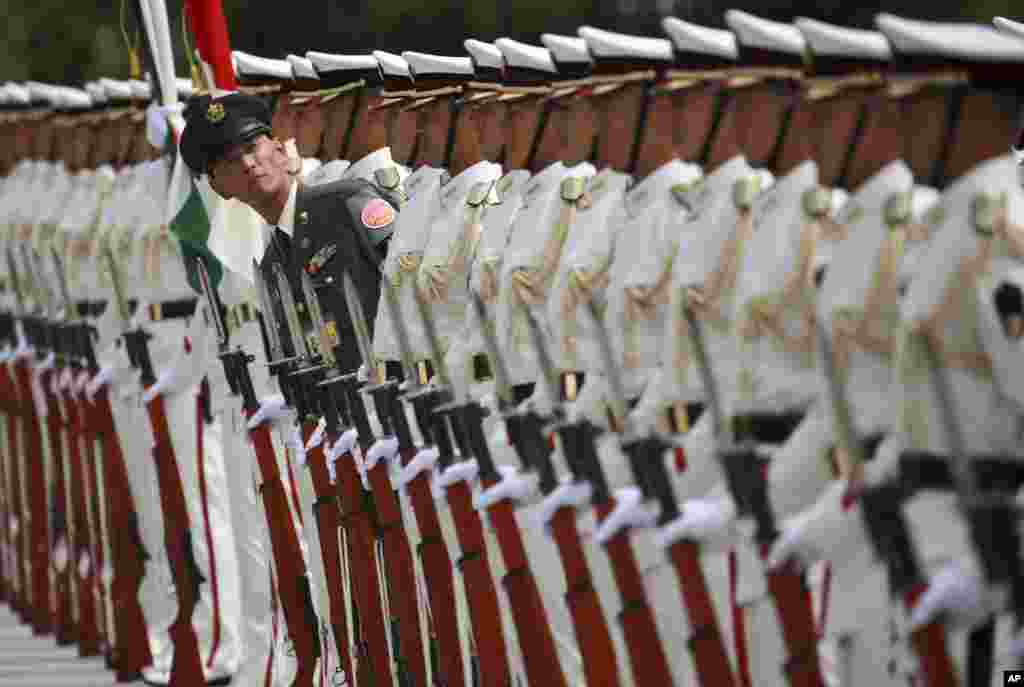 Japanese honor guard members prepare for inspection by Indian Defense Minister Arun Jaitley at the Defense Ministry in Tokyo.