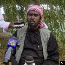 Al-Shabab spokesperson Ali Mohamud Rage holds a news conference in Mogadishu, Somalia, threatening Kenya, October 17, 2011.
