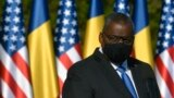 US Defense Secretary Lloyd Austin stands during a joint press conference with Romanian Defense Minister Nicolae Ciuca in Bucharest, Romania, Oct. 20, 2021. Austin visited Romania before attending the NATO Defense Ministerial in Brussels.