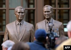 Statues of former Presidents George W. Bush (L) and his father George H.W. Bush are on display during a tour of the George W. Bush Presidential Center on the campus of Southern Methodist University in Dallas, Texas, Apr. 24, 2013.