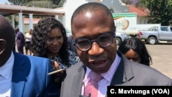 Mthuli Ncube, Zimbabwe's new finance minister, talking to reporters after taking oath of office in Harare, Sept. 10, 2018.