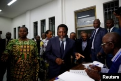 DRC President Joseph Kabila smiles as he arrives to vote at a polling station in Kinshasa, Democratic Republic of Congo, Dec. 30, 2018.