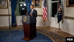 Presiden Amerika Barack Obama memberikan pernyataannya mengenai kesepakatan anggaran, Jumat malam (8/4).