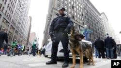 New York City Police K9 officer Kirk Boone and his police dog Kato keep their eyes and ears on crowds attending Super Bowl attractions on Broadway, Friday, Jan. 31, 2014 in New York.