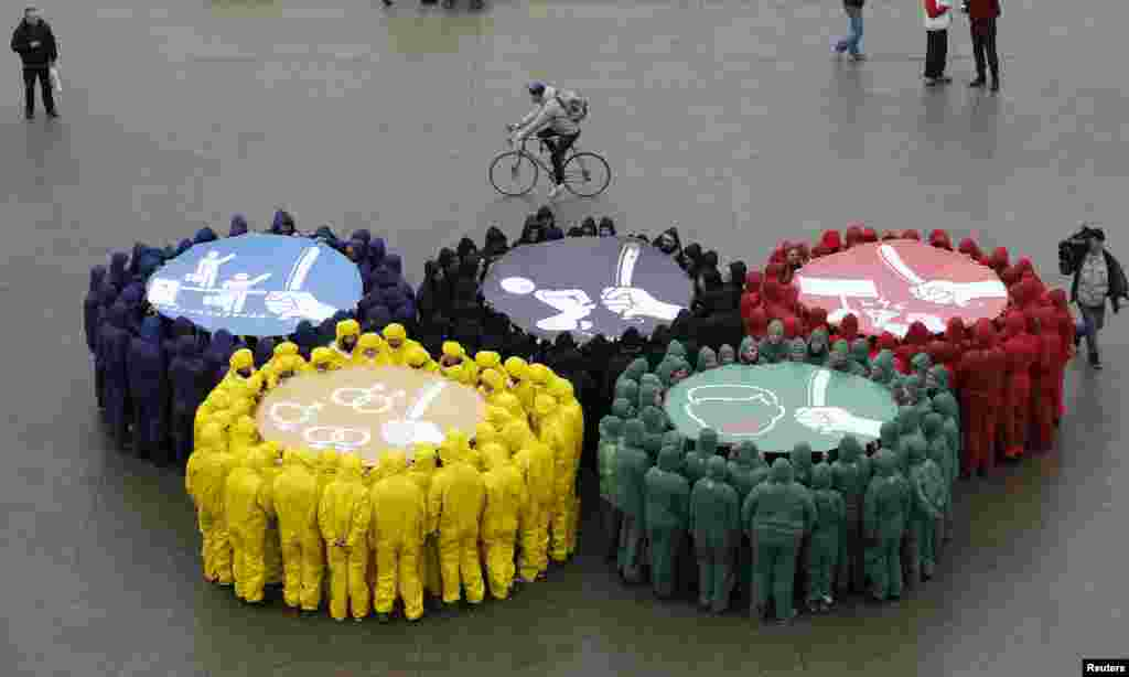 Olympic rings are displayed in Paris, France, with images against restriction of speech and freedom of information, repression of demonstrations, discrimination due to sexual orientation and migrant's exploitation, as part of a protest by human rights organizations a week before of the Sochi Winter Olympic Games.