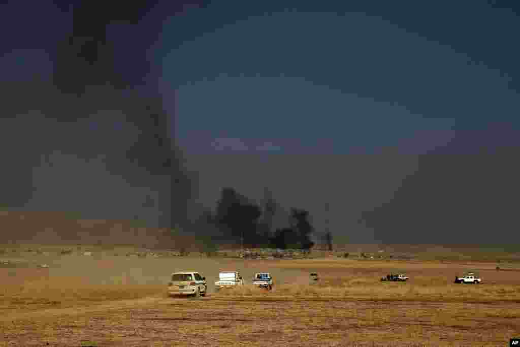 A peshmerga convoy drives towards a frontline in Khazer, about 30 kilometers east of Mosul. The Iraqi military and the country's Kurdish forces say they launched operations to the south and east of militant-held Mosul early Monday morning.