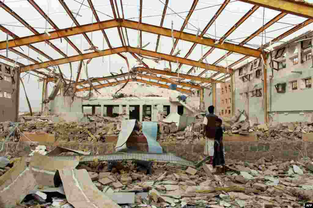 Yemenis inspect the damage caused by a Saudi-led airstrike on a cholera treatment center supported by Doctors Without Borders (MSF) in the Abs region of Yemen. MSF said it has temporarily frozen operations in the rebel-held area of northwestern Yemen following the airstrike which caused no casualties.