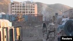 Soldiers walk towards the U.S. Consulate after an attack by insurgents in Herat, Afghanistan, Sept. 13, 2013.