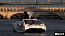 The Bubbles water taxi is seen on the River Seine during a demonstration by the SeaBubbles company in Paris, France, September 16, 2019.