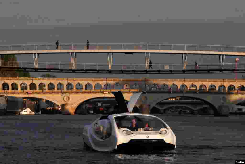 The Bubbles water taxi is seen on the River Seine during a demonstration by the SeaBubbles company in Paris, France.