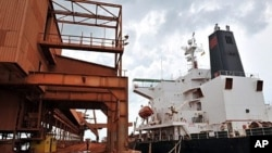 A cargo ship is loaded with bauxite at the bauxite factory of Guinea's largest mining firm, Compagnie des Bauxites de Guinee (CBG), at Kamsar, a town north of the capital Conakry (2008 file photo)