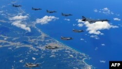 This handout photo taken Sept. 18, 2017, and provided by the South Korean Defense Ministry in Seoul shows U.S. and South Korean fighter jets flying over South Korea during a joint military drill aimed to counter North Korea's latest nuclear and missile tests.