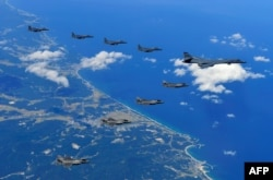 This handout photo taken Sept. 18, 2017 and provided by the South Korean Defense Ministry in Seoul shows U.S. and South Korean fighter jets flying over South Korea during a joint military drill aimed to counter North Korea's latest nuclear and missile tes