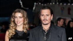 FILE - Actor Johnny Depp and wife Amber Heard