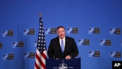 U.S. Secretary of State Mike Pompeo talks to journalists during a news conference during a NATO Foreign Ministers meeting at the NATO headquarters in Brussels, Wednesday, Nov. 20, 2019.