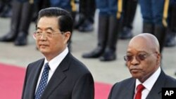 South African President Jacob Zuma, right, walks with Chinese President Hu Jintao during a welcome ceremony held outside the Great Hall of the People in Beijing, (File).
