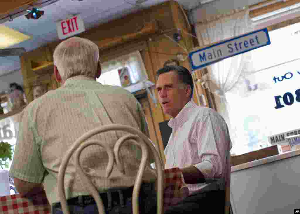 Republican presidential candidate, former Massachusetts Gov. Mitt Romney meets with local business leaders and farmers during a campaign stop in Council Bluffs, Iowa, June 8, 2012.