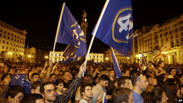 Opposition supporters reacts on the street in Tbilisi Georgia, Monday, Oct. 1, 2012.