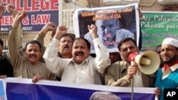 Pakistani protesters rally to condemn the arrest in London of WikiLeaks founder Julian Assange, seen in poster, during a protest in Multan, Pakistan, on Dec. 9, 2010.